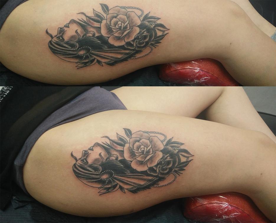 Tatuaggio volto femminile con rosa-1